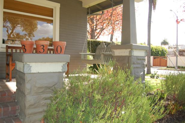 Use your terracotta pots for clever decor like these pots used for house numbers.