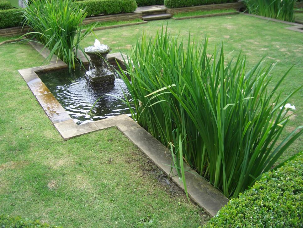 16 landscape ideas that use water features hgtv Water fountain landscaping ideas