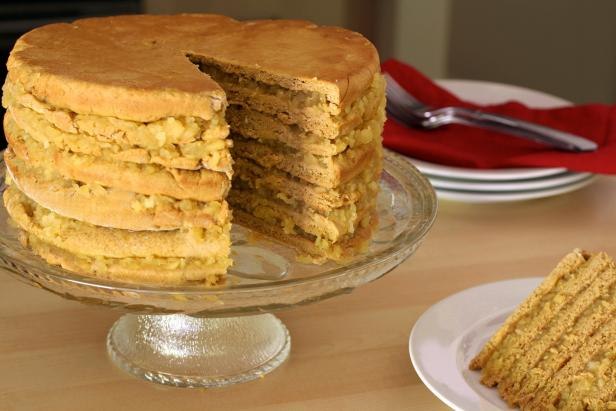 Stiff dough and sweet apple filling tower ever-higher when building an apple stack cake.