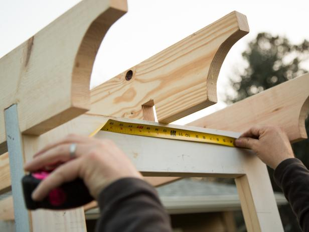 Once the outside pieces are secured into place, measure for the center, and install the third board.