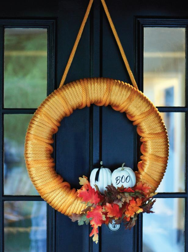 Hang your festive orange Halloween wreath with a built in hanger.