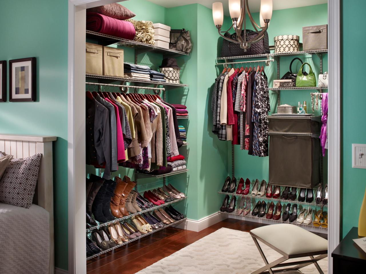 Master Closet Design Ideas large walk in closet in classic style with crystal chandelier and vintage chair Classic Sense Of Style