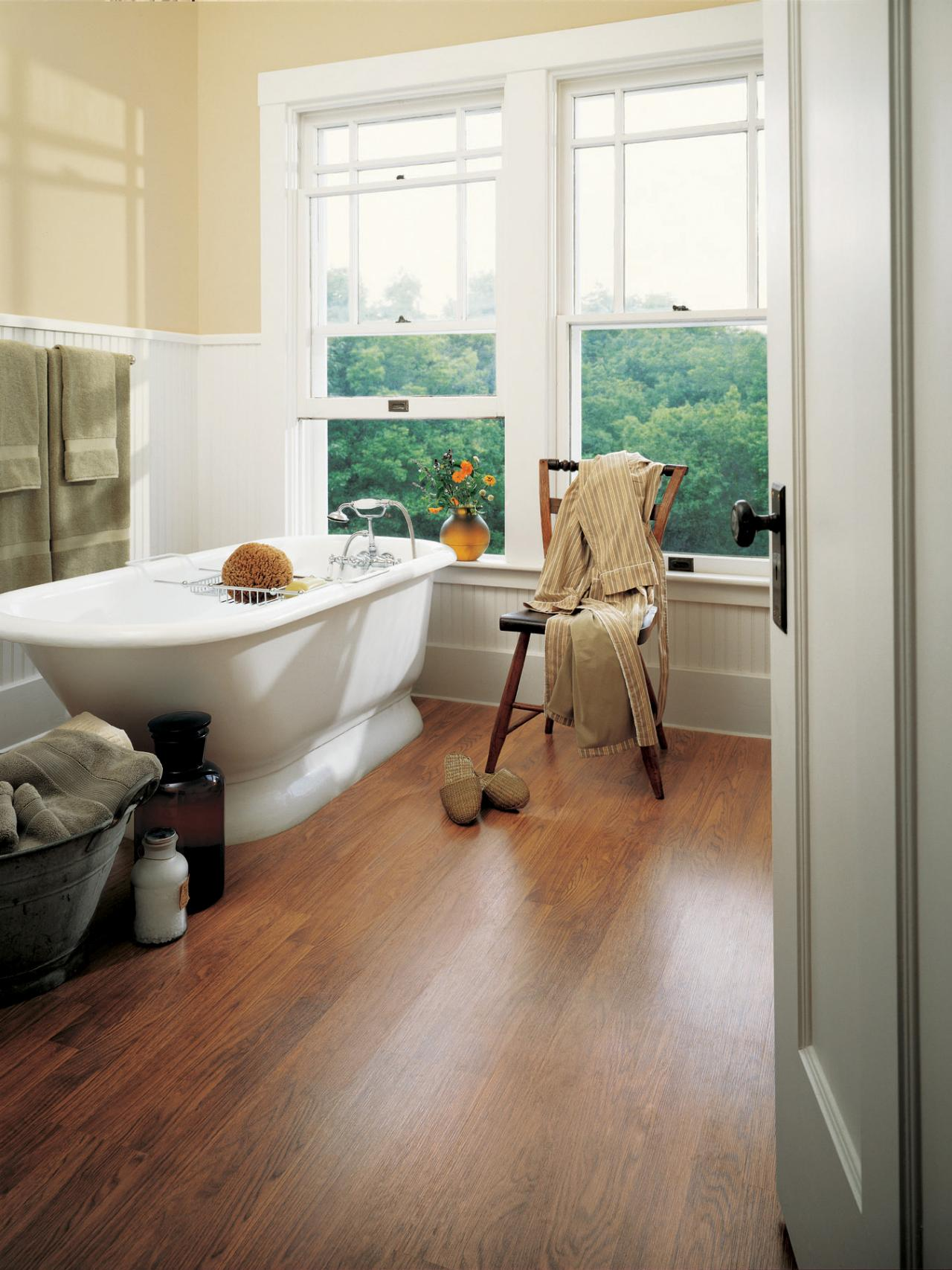 Choosing bathroom flooring hgtv - Laminate tiles for bathroom walls ...