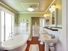 The hotel-chic bathroom boasts a vintage-style soaking tub, a spa shower and custom touches that incorporate architectural salvage.