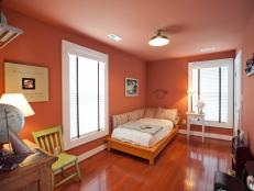 Sherbet-colored walls and vintage schoolhouse accessories elevate the mood of this happy-chic sleeping space.