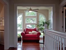 A cozy nook situated on the home's third floor provides a space to read or reflect.