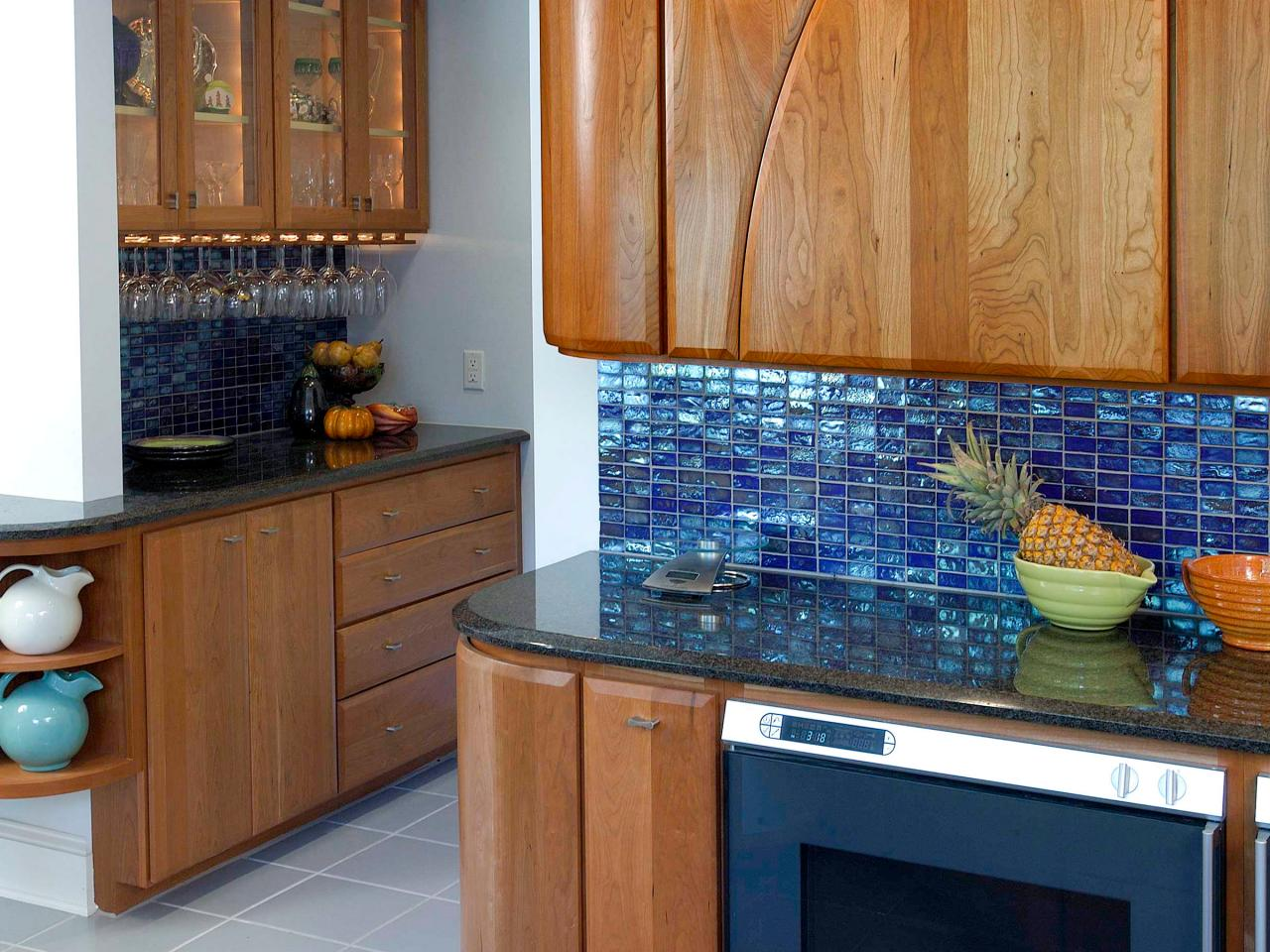Steep glass tile backsplash an option for larger budgets glass tile backsplashes offer distinct Design kitchen backsplash glass tiles