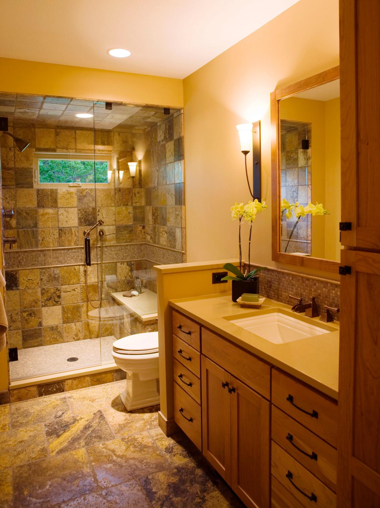 three quarter bathroom with marble tile floor to ceiling marble tile