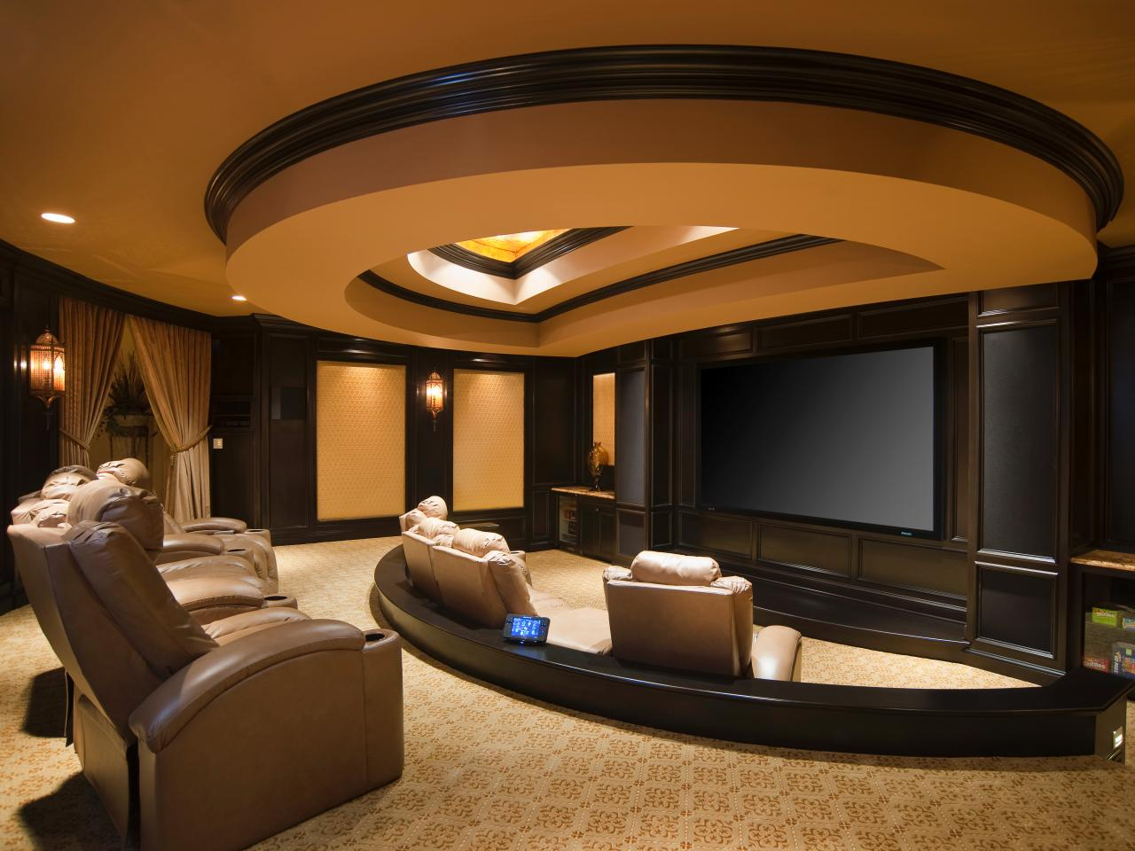 Home Theater Room Design Ideas magnificent home theater room design ideas with super large led tv attached to the wall and beige fabric material comfortable sofa equipped with orange Mountain Motif