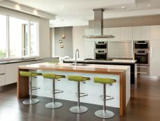 Modern White Kitchen With Green Stools at Eat-In Island
