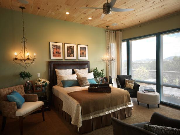 Green and Brown Rustic Bedroom With Wood Beam Ceiling