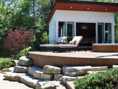 Modern Curved Deck With Large Stones