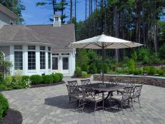 Paver Patio with Outdoor Dining Area and Umbrella
