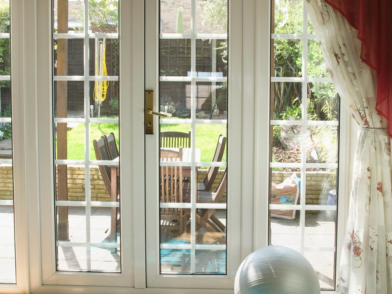 Hinged patio doors hgtv for Single exterior patio door
