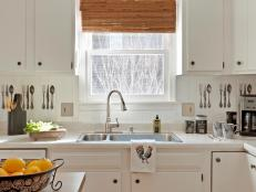 Cottage Kitchen With White Cabinets and Countertops