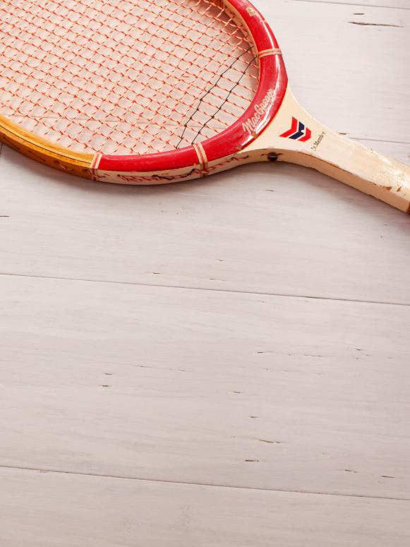 White Bamboo Flooring and Tennis Racket