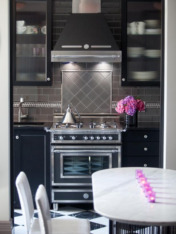 Eat-In Kitchen With Gray Glass Tile Backsplash