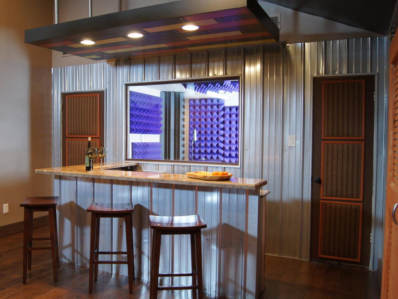 Industrial basement bar with metal siding hgtv - Home bar room ideas ...