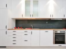 White Modern Kitchen with Dark Gray Tile Backsplash