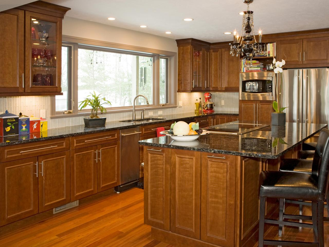 Dark Wood Kitchen Cabinets With Patterned Backsplash