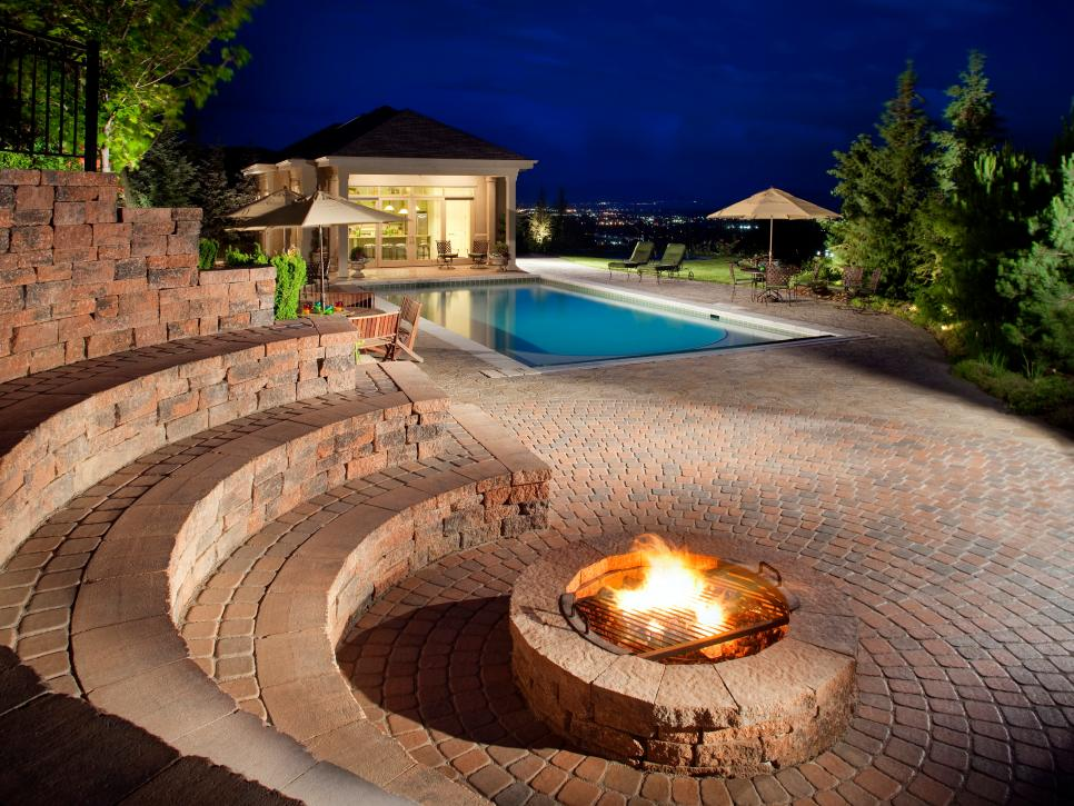 Pool Deck Ideas above ground pool deck ideas with pebble stone around pool also vinyl lattice deck skirting in white Photo By Chipper Hatter