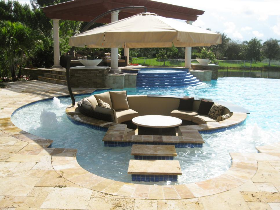 Outdoor Design Ideas black patio pergola double sided outdoor fireplace concrete Dreamy Pool Design Ideas Hgtv
