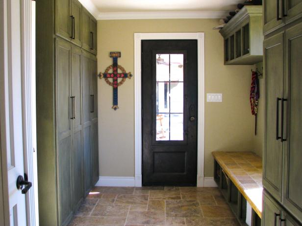 Rustic Mudroom With Green Cabinets