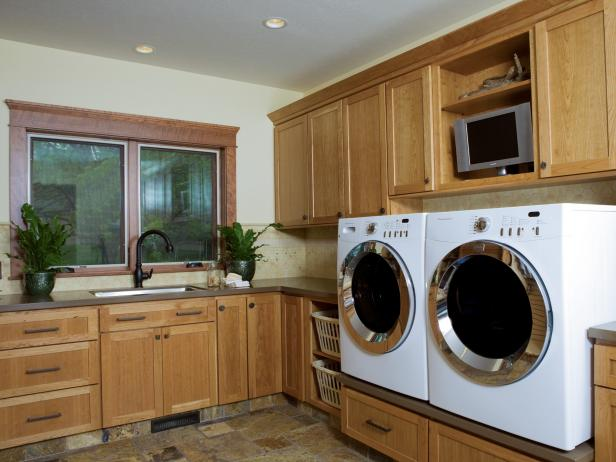 Neutral Laundry Room With Wood Cabinets