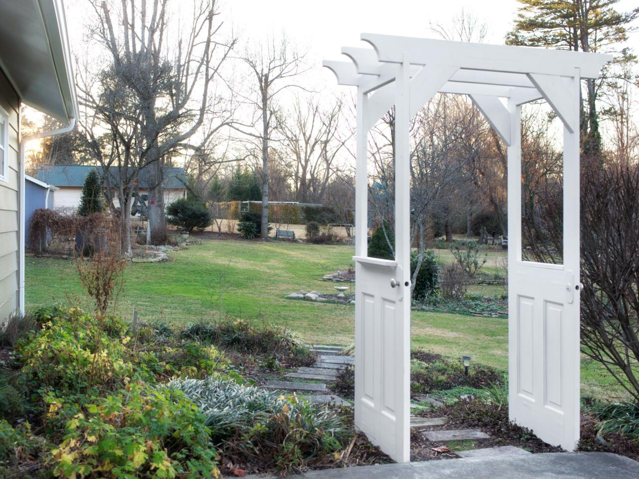 Make a garden arbor from old wooden doors how tos diy for Outdoor garden doors