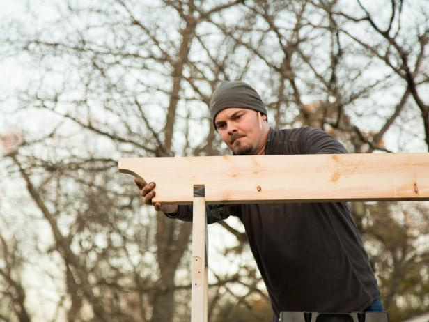 Step 11: Attach First Two Arbor Top BoardsPosition the outside pieces of wood so that they are flush with the edge of each door. Tap wood with hammer to secure a snug fit, then attach with 2 1/2â outdoor wood screws using drill.