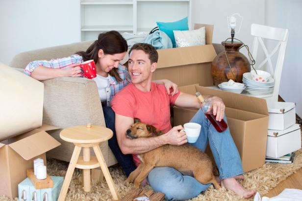Couple + Pup Unpacking New Home