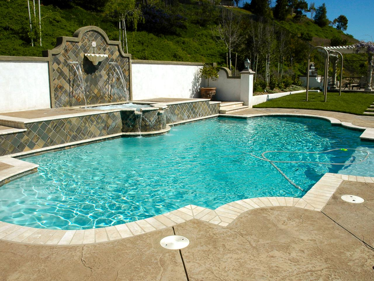 Mediterranean inspired swimming pools outdoor spaces patio ideas decks gardens hgtv - Outdoor decoratie zwembad ...