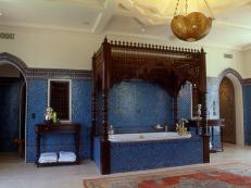 moroccan influenced bath features tub with canopy