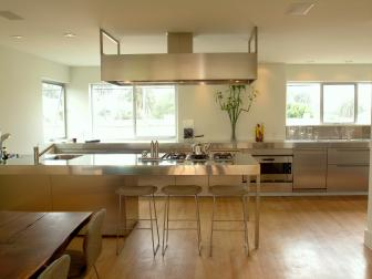 Silver and White Contemporary Kitchen With Range Hood
