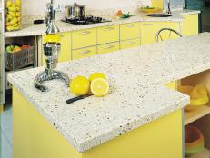Kitchen With Caesarstone Countertop and Yellow Cabinets