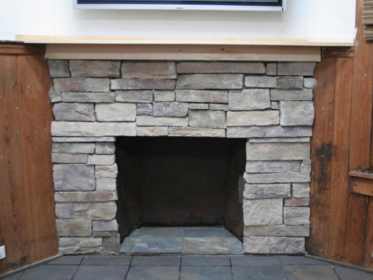 Design Stone Around Fireplace how to cover a brick fireplace with stone hgtv stone