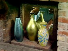 Painted Vases and Mirror In Fireplace