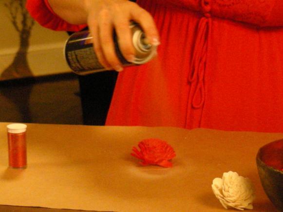 Pomander_Balls_-_Spraying_Glue_on_Flowers