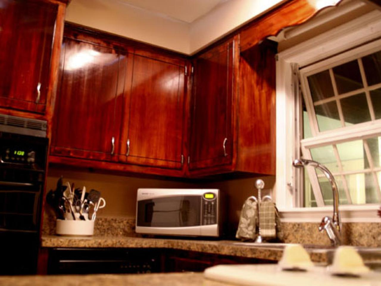 how to give your kitchen cabinets a makeover  hgtv - related to kitchen cabinets cabinets how to kitchens painting andfinishing staining hdswtcbafterkitchencabinets
