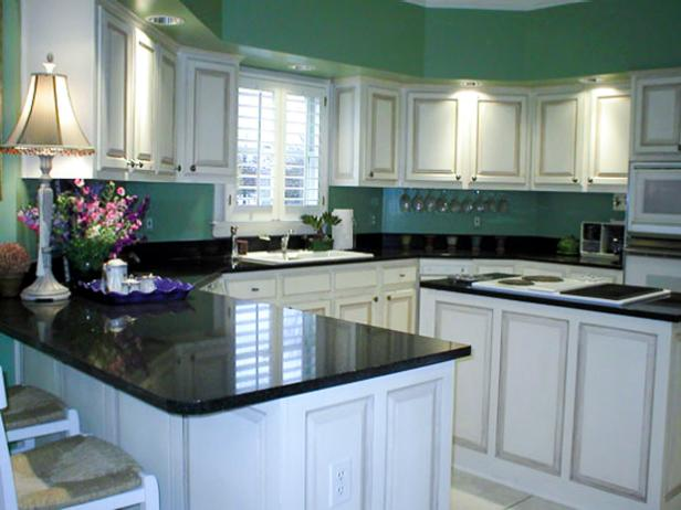 Green and White Traditional Eat-In Kitchen With Dark Countertops