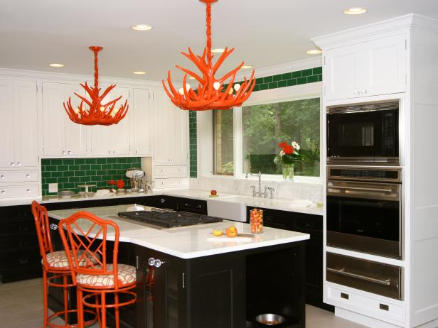 Eclectic Kitchen with Green Tile and Orange Accents
