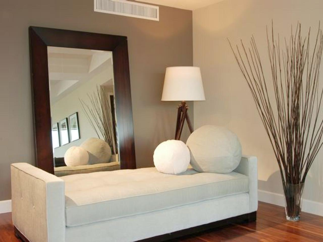 How to hang a heavy mirror hgtv Brown wall color living room