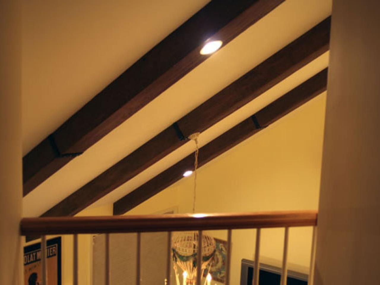 Faux ceiling beams create rustic feel hgtv for Fake wood beams for ceiling