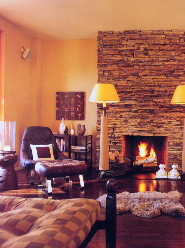 Yellow Rustic Living Room With Stone Fireplace