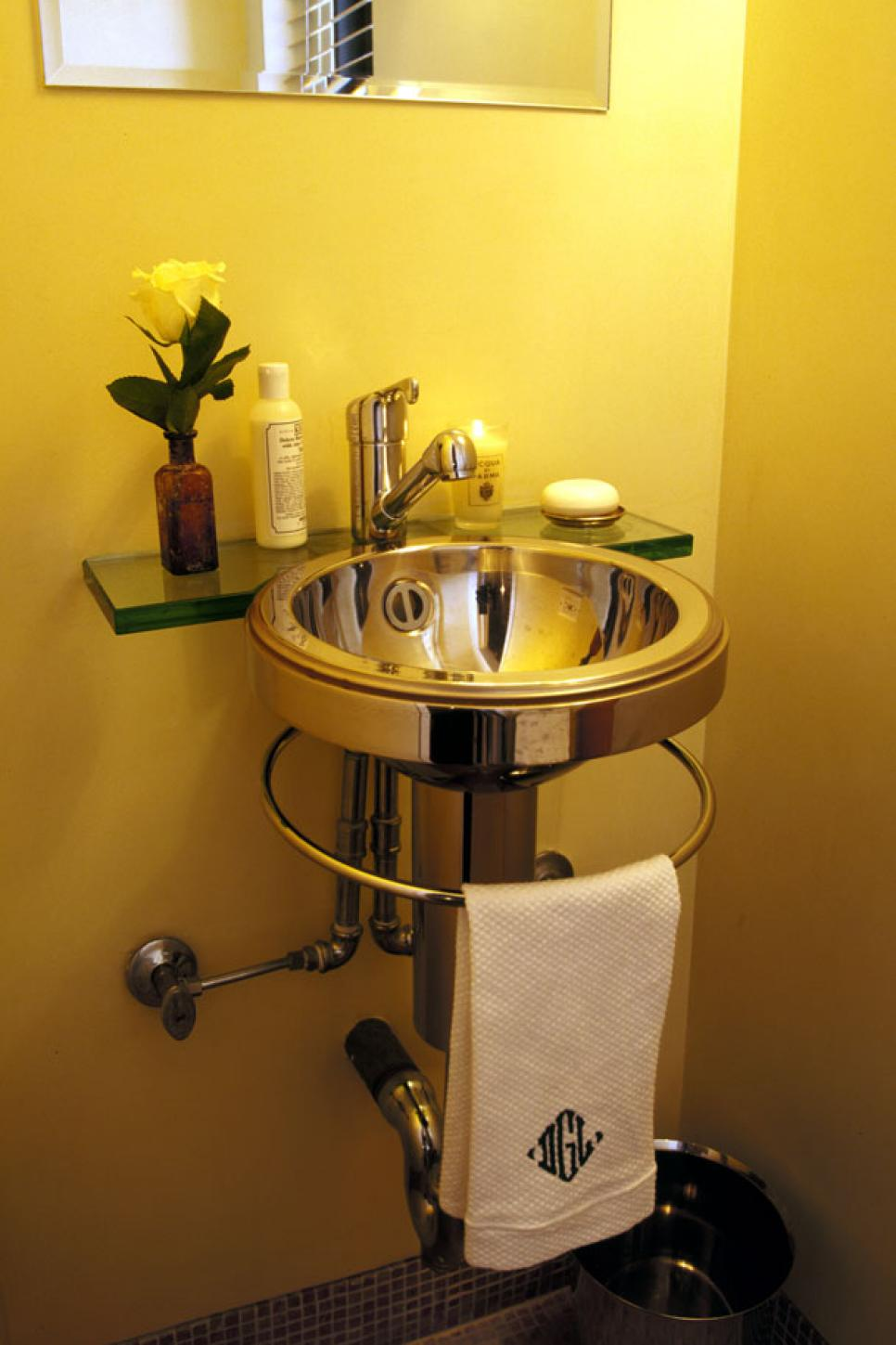 Make a statement in your powder room hgtv for Bathroom yellow paint