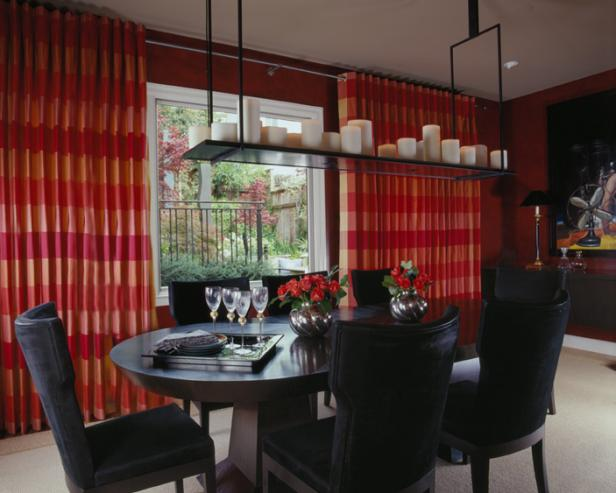 Red Dining Room With Black Table and Chairs