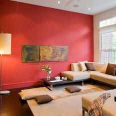 Modern Asian Living Room With Beige Sectional and Red Wall