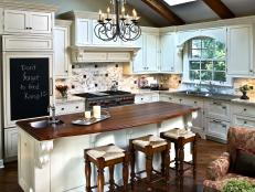 Traditional White Kitchen With Wood Accents and Iron Chandelier