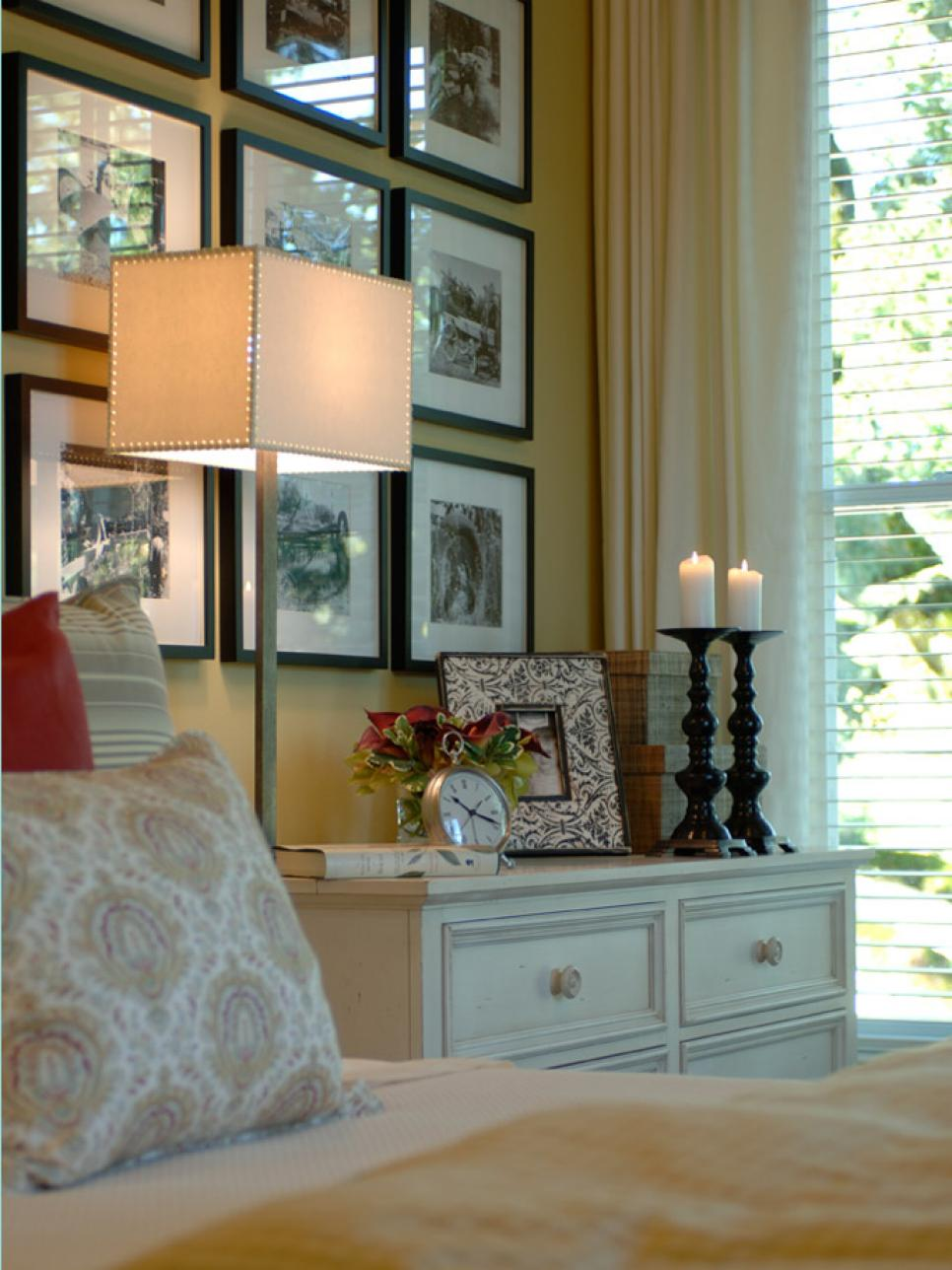 10 ways to display bedroom frames hgtv for Bedroom picture ideas