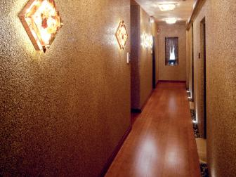 Gold Hallway With Sconces